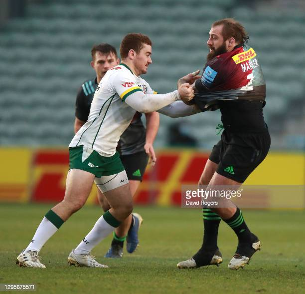 Joe Marler of Harlequins is tackled by Paddy Jackson during the Gallagher Premiership Rugby match between Harlequins and London Irish at Twickenham...