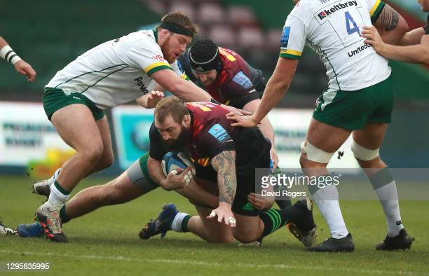 Joe Marler of Harlequins is tackled during the Gallagher Premiership Rugby match between Harlequins and London Irish at Twickenham Stoop on January...
