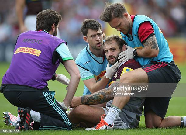 Joe Marler of Harlequins receives treatment after being injured during the Aviva Premiership match between Harlequins and Saracens at Twickenham...