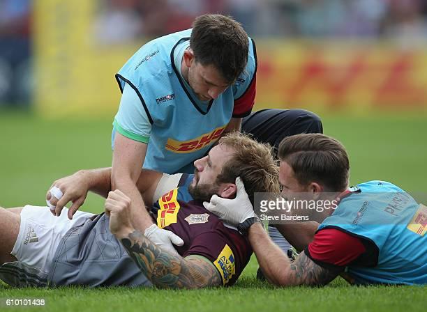 Joe Marler of Harlequins receives treatment after being injured during the Aviva Premiership match between Harlequins and Saracens at Twickenham...