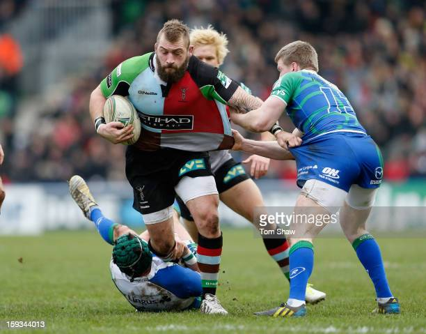 Joe Marler of Quins is tackled during the Heineken Cup match between Harlequins and Connacht Rugby at Twickenham Stoop on January 12 2013 in London...
