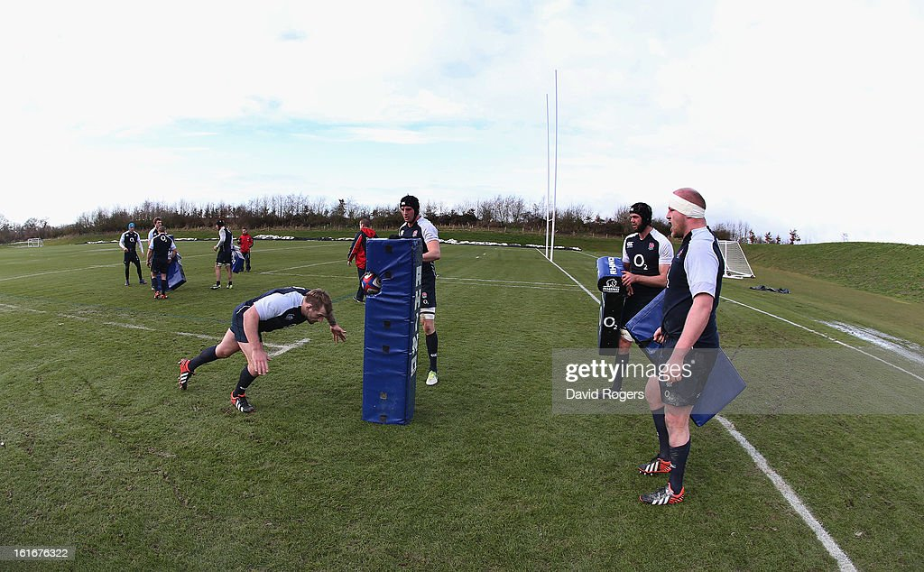 Joe Marler pratices his tackling during the England training session held at St Georges Park on February 14, 2013 in Burton-upon-Trent, England.