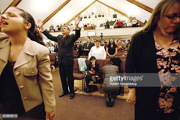 Joe Martinez prays with Josiah his 5yearold son during a twohour English Sunday service at a Christian Pentecostal evangelical church in the Bay...
