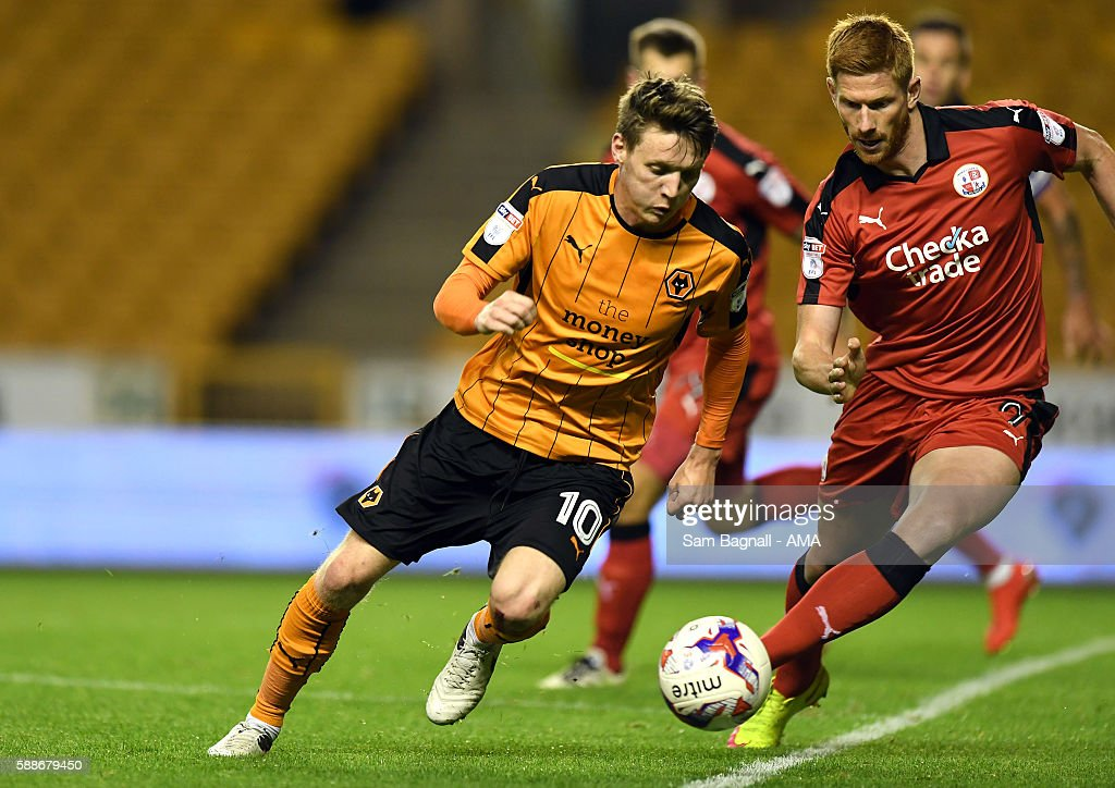 Joe Mason of Wolverhampton Wanderers and Matt Harrold of Crawley Town during the EFL Cup match between Wolverhampton Wanderers and Crawley Town at Molineux on August 8, 2016 in Wolverhampton, England.