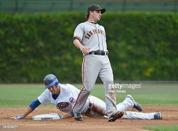 Joe Mather of the Chicago Cubs steals second base as second baseman Ryan Theriot of the San Francisco Giants waits for the throw during the first...