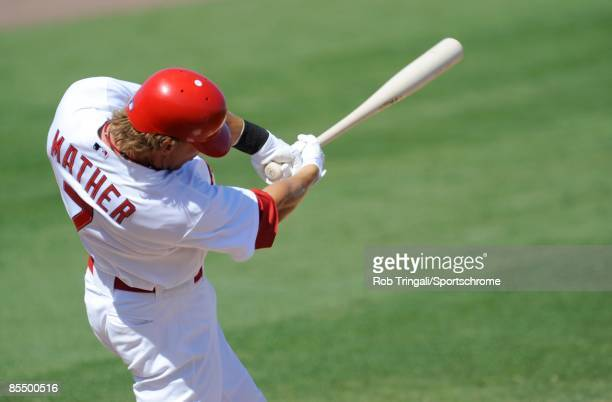 Joe Mather of the St Louis Cardinals bats against the Washington Nationals during a spring training game at Roger Dean Stadium on February 28 2009 in...