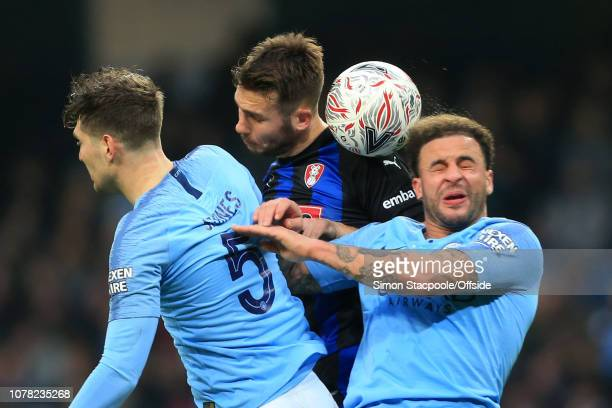 Joe Mattock of Rotherham battles with John Stones of Man City and Kyle Walker of Man City during the FA Cup Third Round match between Manchester City...