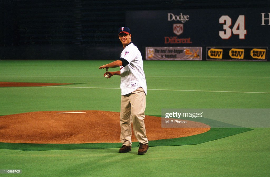 Joe Mauer, first pick in the 2001 draft, throws out the first pitch prior to the game between the Oakland Athletics and the Minnesota Twins at the Metrodome on July 18, 2001 in Minneapolis, Minnesota.