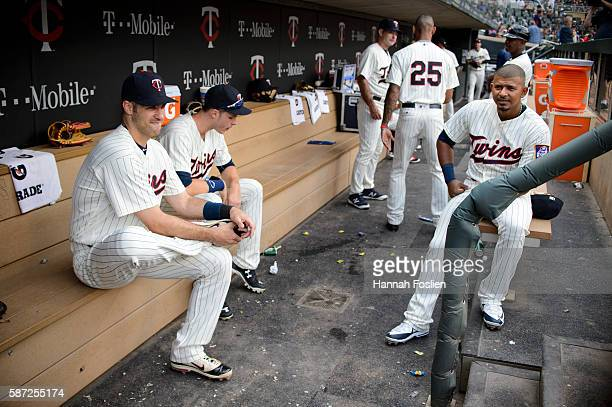 Joe Mauer Max Kepler and Eduardo Escobar of the Minnesota Twins wait in the dugout for the start of the game against the Chicago White Sox on July 30...