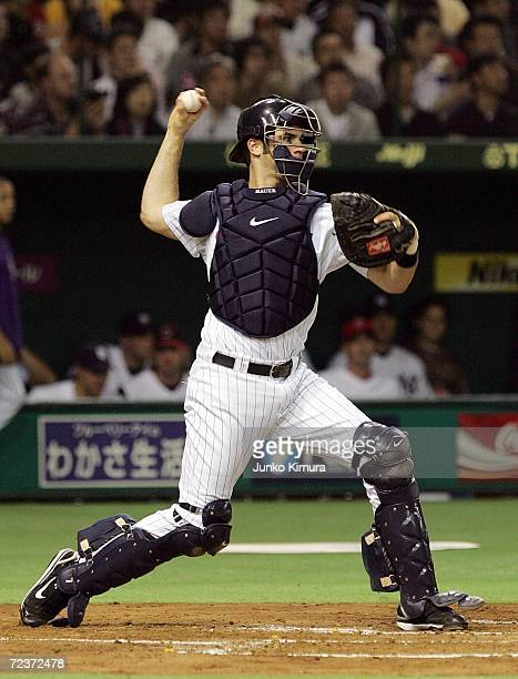 Joe Mauer of Minnesota Twins throws the ball during the Aeon All Star Series 2006 against Japan All-Star at Tokyo Dome on November 3, 2006 in Tokyo,...