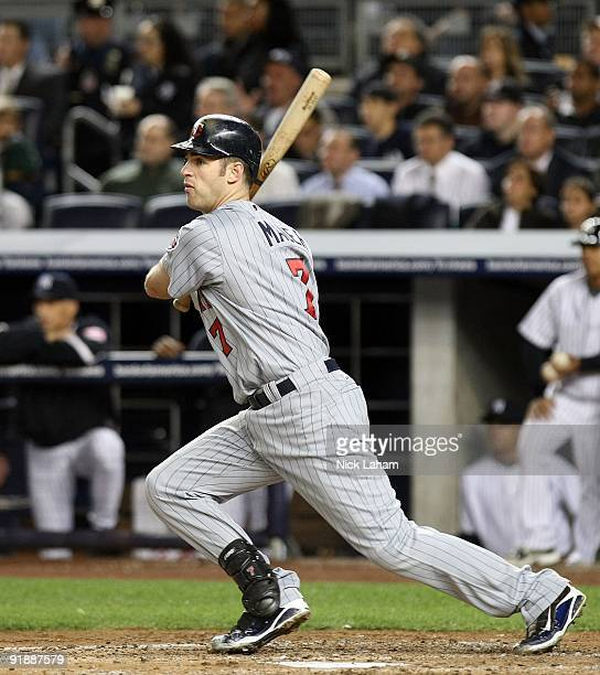 Joe Mauer of the Minnesota Twins at bat against the New York Yankees in Game One of the ALDS during the 2009 MLB Playoffs at Yankee Stadium on...