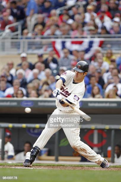 Joe Mauer of the Minnesota Twins bats against the Boston Red Sox on April 12 2010 at Target Field in Minneapolis Minnesota The Twins won 52