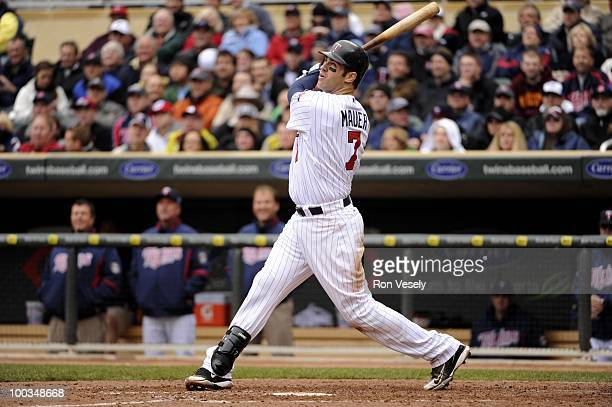 Joe Mauer of the Minnesota Twins bats against the Chicago White Sox on May 12 2010 at Target Field in Minneapolis Minnesota The Twins defeated the...