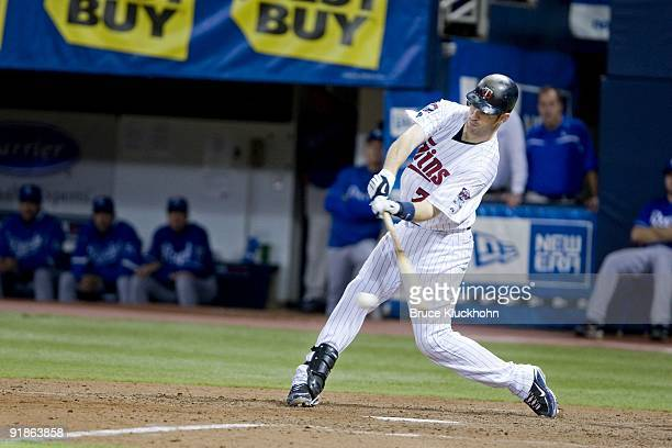 Joe Mauer of the Minnesota Twins bats against the Kansas City Royals on October 4, 2009 at the Metrodome in Minneapolis, Minnesota. The Twins won...