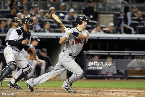 Joe Mauer of the Minnesota Twins bats against the New York Yankees in Game One of the ALDS during the 2009 MLB Playoffs at Yankee Stadium on October...