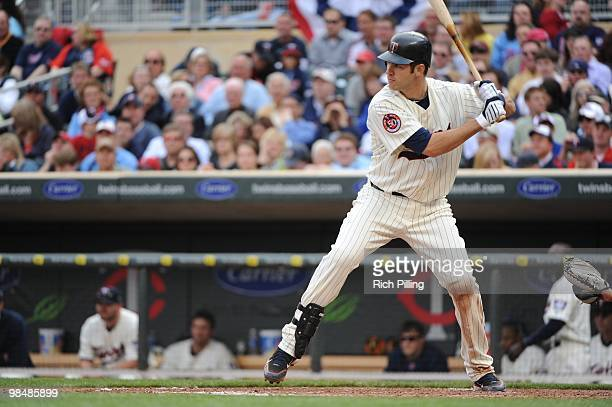 Joe Mauer of the Minnesota Twins bats during the Opening Day game against the Boston Red Sox at Target Field in Minneapolis Minnesota on April 12...