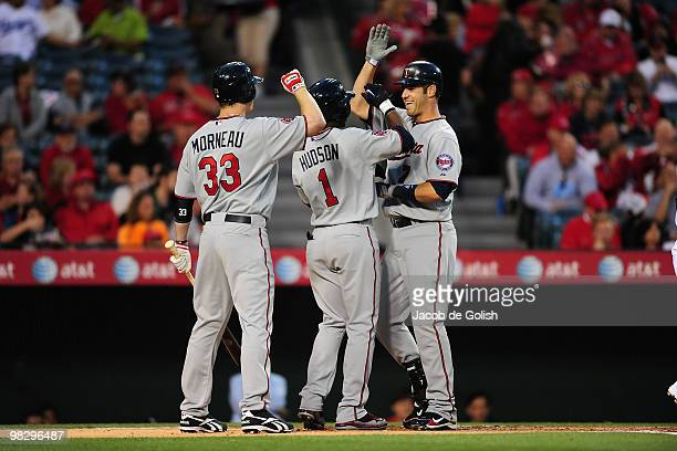 Joe Mauer of the Minnesota Twins celebrates after hitting a two run homerun in the first inning against the Los Angeles Angels of Anaheim on April 6...