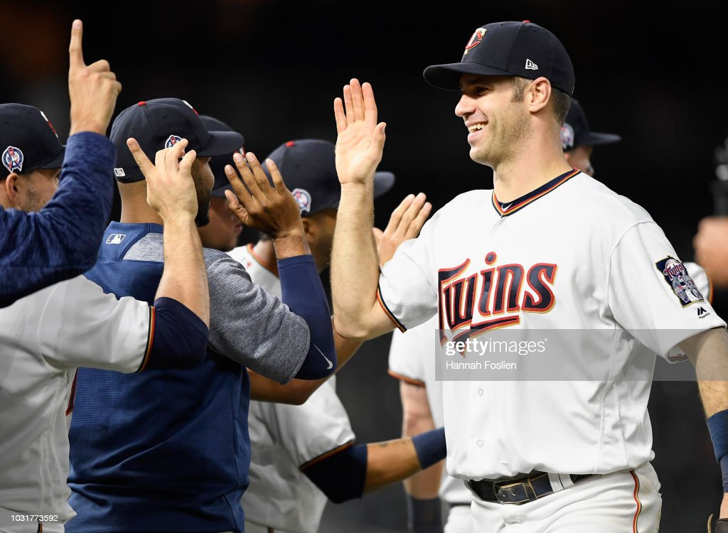 Joe Mauer #7 of the Minnesota Twins celebrates defeating the New York Yankees 10-5 after the game on September 11, 2018 at Target Field in Minneapolis, Minnesota.