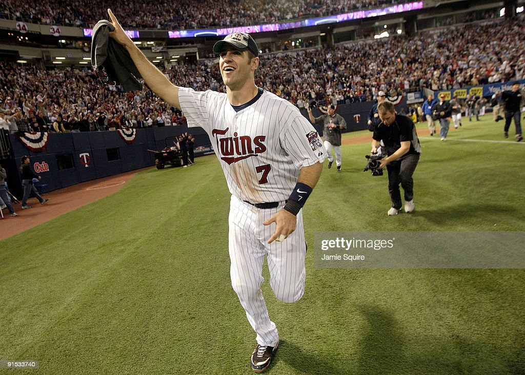 Joe Mauer #7 of the Minnesota Twins circles the field after the Twins defeated the Detroit Tigers to win the American League Tiebreaker game on October 6, 2009 at Hubert H. Humphrey Metrodome in Minneapolis, Minnesota.