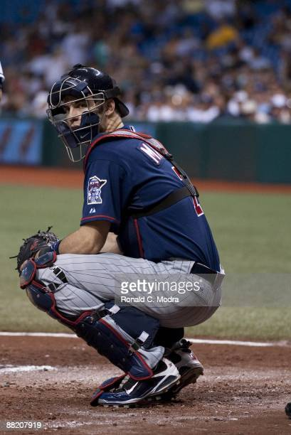 Joe Mauer of the Minnesota Twins crouches behind the plate during a game against the Tampa Bay Rays at Tropicana Field on May 29 2009 in St...