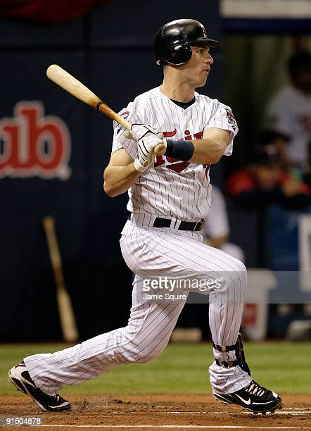 Joe Mauer of the Minnesota Twins doubles during the 1st inning of the American League Tiebreaker game against the Detroit Tigers on October 6 2009 at...