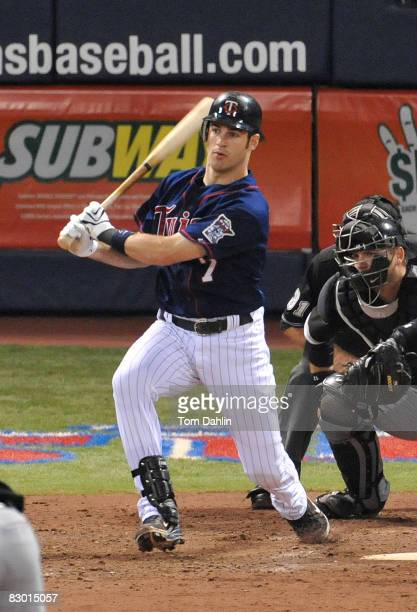 Joe Mauer of the Minnesota Twins follows through after a hit during an MLB game against the Chicago White Sox at the Hubert H. Humphrey Metrodome...