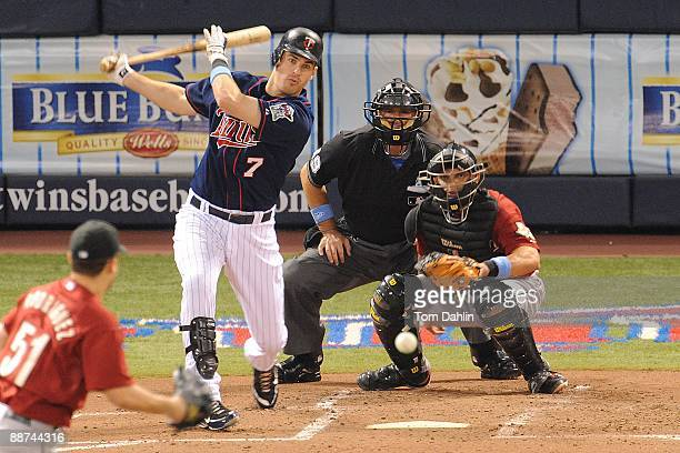 Joe Mauer of the Minnesota Twins follows through on a hit during an MLB game against the Houston Astros at the Hubert H Humphrey Metrodome June 21...