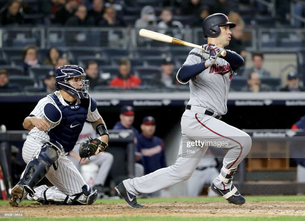 Joe Mauer #7 of the Minnesota Twins grounds out as Gary Sanchez #24 of the New York Yankees defends at Yankee Stadium on April 24, 2018 in the Bronx borough of New York City.
