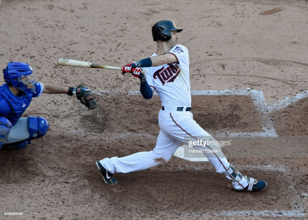 Joe Mauer #7 of the Minnesota Twins hits a grand slam as Raffy Lopez #1 of the Toronto Blue Jays during the fifth inning of the game on September 17, 2017 at Target Field in Minneapolis, Minnesota. The Twins defeated the Blue Jays 13-7.