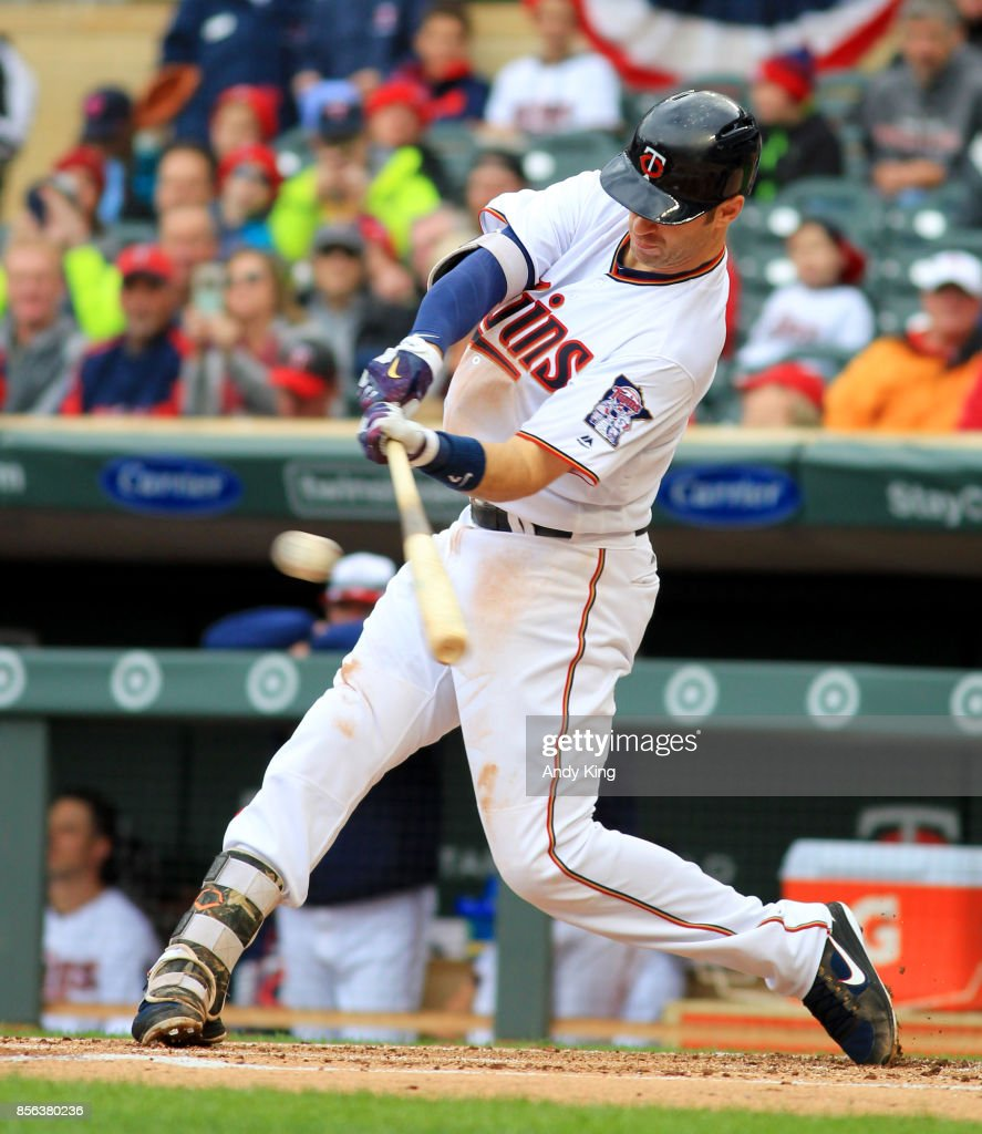 Joe Mauer #7 of the Minnesota Twins hits a RBI double against the Detroit Tigers in the first inning during their baseball game on October 1, 2017, at Target Field in Minneapolis, Minnesota.