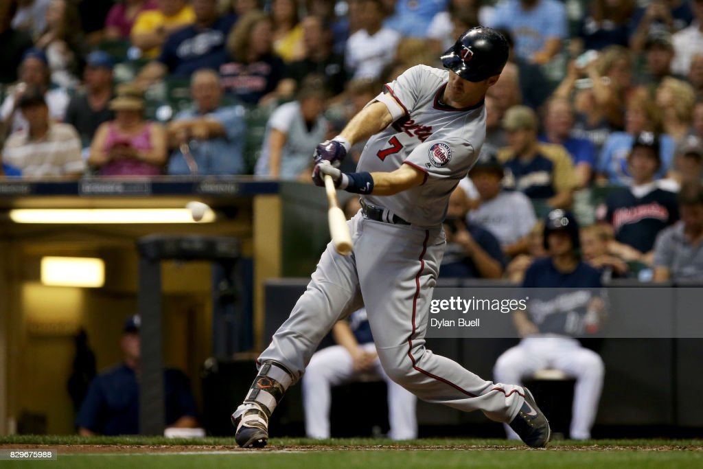 Joe Mauer #7 of the Minnesota Twins hits a single in the third inning against the Milwaukee Brewers at Miller Park on August 10, 2017 in Milwaukee, Wisconsin.