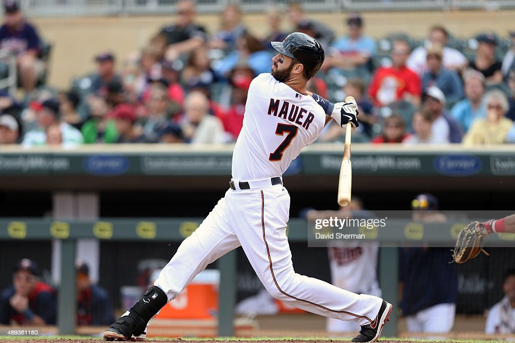 Joe Mauer #7 of the Minnesota Twins hits a solo home run in the 8th inning against the Los Angeles Angels of Anaheim at Target Field on September 20, 2015 in Minneapolis, Minnesota. The Twins defeated the Angels 8-1.