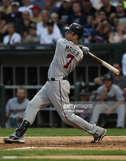 Joe Mauer of the Minnesota Twins hits a tworun home run in the 2nd inning against the Chicago White Sox at US Cellular Field on August 10 2010 in...