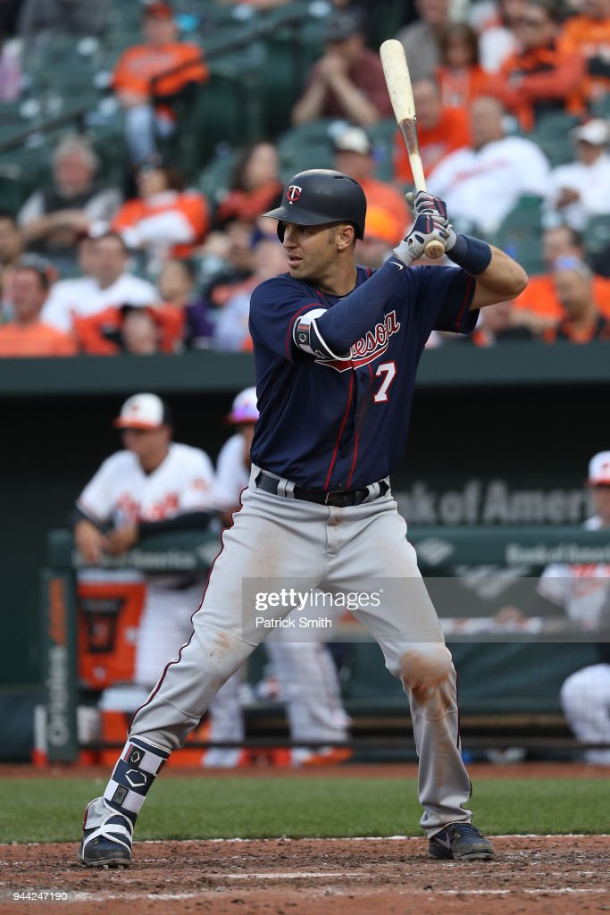 Joe Mauer #7 of the Minnesota Twins hits against the Baltimore Orioles in their Opening Day game at Oriole Park at Camden Yards on March 29, 2018 in Baltimore, Maryland.