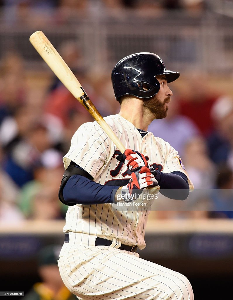 Joe Mauer #7 of the Minnesota Twins hits an RBI single against the Oakland Athletics during the seventh inning of the game on May 6, 2015 at Target Field in Minneapolis, Minnesota. The Twins defeated Athletics 13-0.