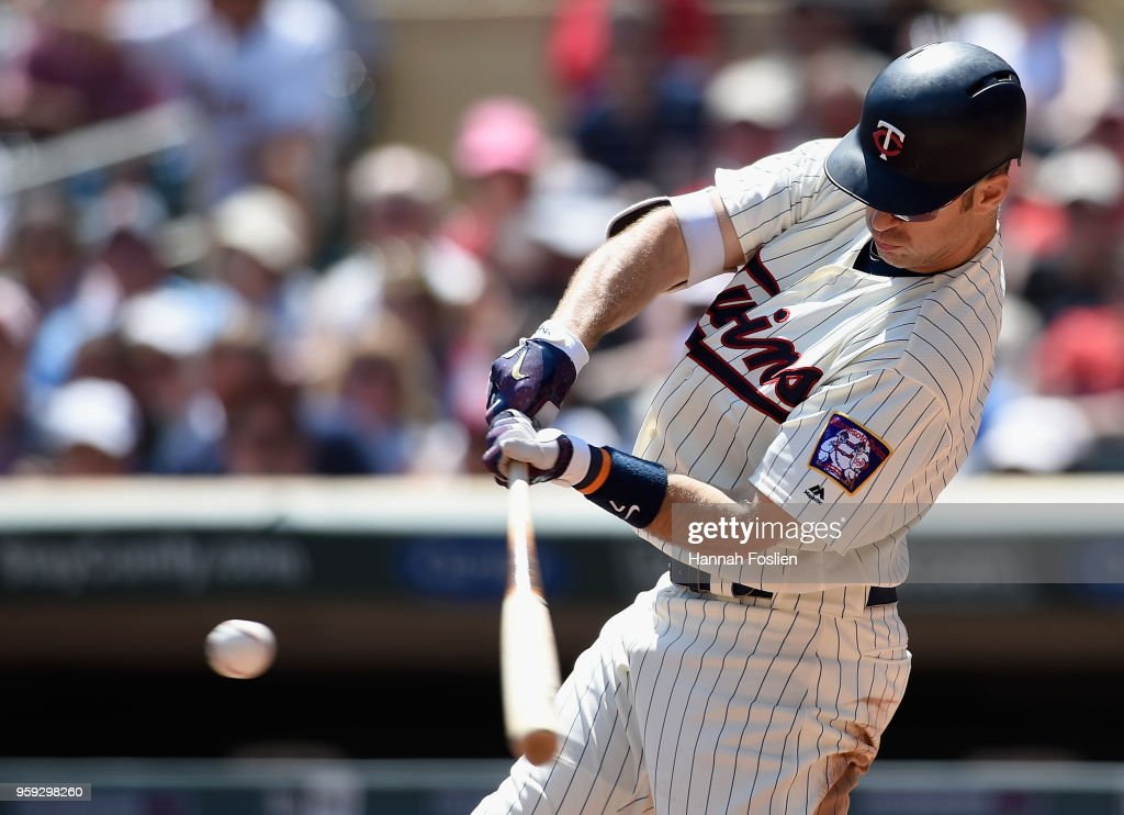 Joe Mauer #7 of the Minnesota Twins hits an RBI single against the St. Louis Cardinals during the second inning of the interleague game on May 16, 2018 at Target Field in Minneapolis, Minnesota. The Cardinals defeated the Twins 7-5.