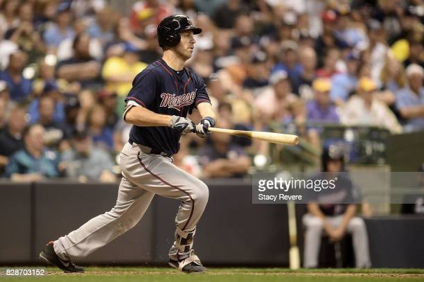 Joe Mauer of the Minnesota Twins hits an RBI single during the seventh inning of a game against the Milwaukee Brewers at Miller Park on August 9 2017...