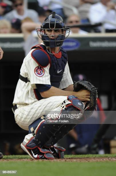 Joe Mauer of the Minnesota Twins in the third inning against the Boston Red Sox during the Twins home opener at Target Field on April 12 2010 in...