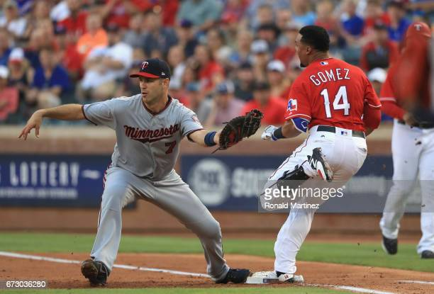 Joe Mauer of the Minnesota Twins makes the out against Carlos Gomez of the Texas Rangers in the first inning at Globe Life Park in Arlington on April...