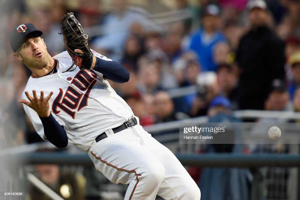 Joe Mauer #7 of the Minnesota Twins misses a catch in foul territory of the ball hit by Robinson Chirinos #61 of the Texas Rangers during the fourth inning of the game on August 3, 2017 at Target Field in Minneapolis, Minnesota.