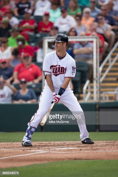 Joe Mauer of the Minnesota Twins pitches during the game against the St Louis Cardinals at Miller Park on March 06 2017 in Milwaukee Wisconsin
