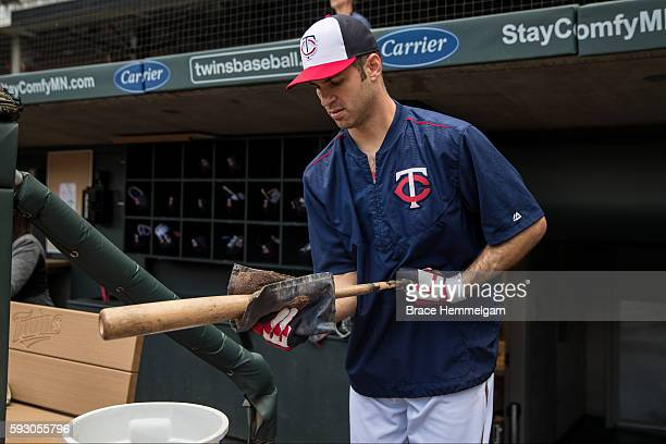 Joe Mauer of the Minnesota Twins puts pine tar on his bat prior to the game against the Houston Astros on August 8 2016 at Target Field in...