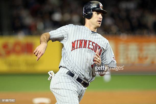 Joe Mauer of the Minnesota Twins runs the bases against the New York Yankees in Game One of the ALDS during the 2009 MLB Playoffs at Yankee Stadium...
