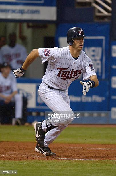 Joe Mauer of the Minnesota Twins runs to firstbase during the game against the Chicago White Sox at the Metrodome on April 9 2005 in Minneapolis...