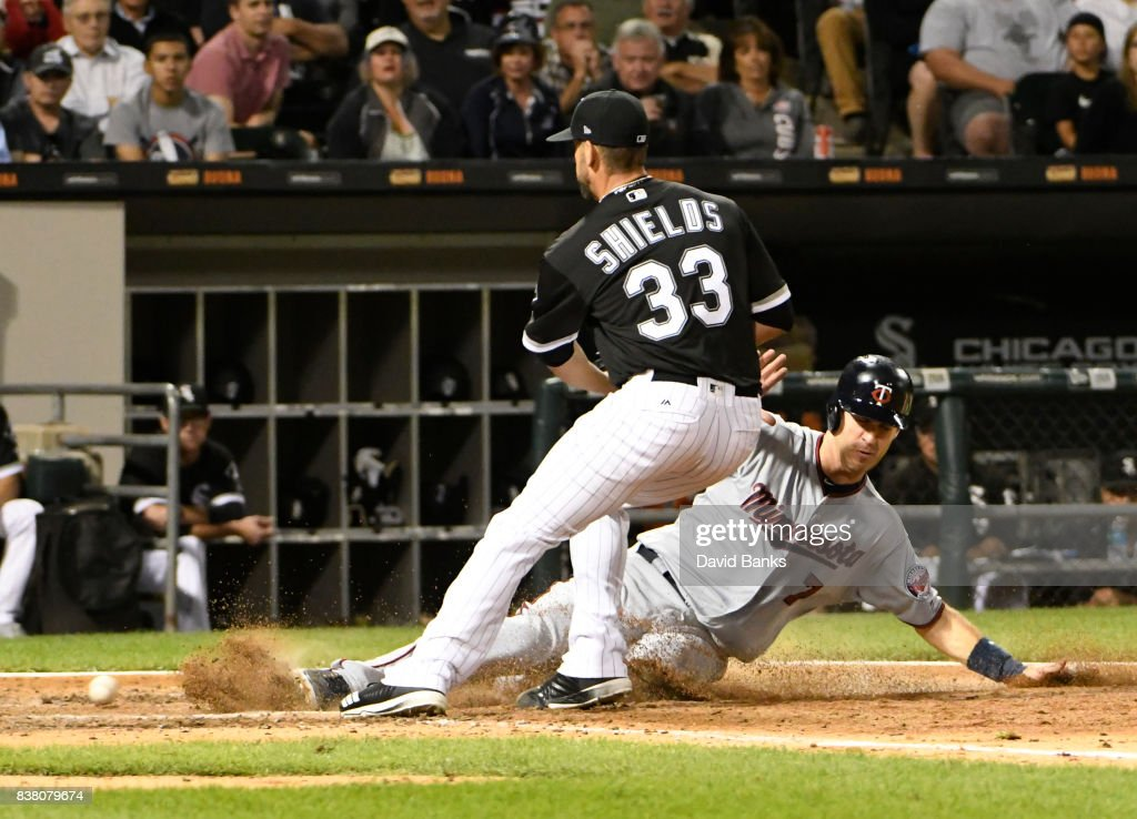 Joe Mauer #7 of the Minnesota Twins scores on a wild pitch as James Shields #33 of the Chicago White Sox covers home plate during the sixth inning on August 23, 2017 at Guaranteed Rate Field in Chicago, Illinois.