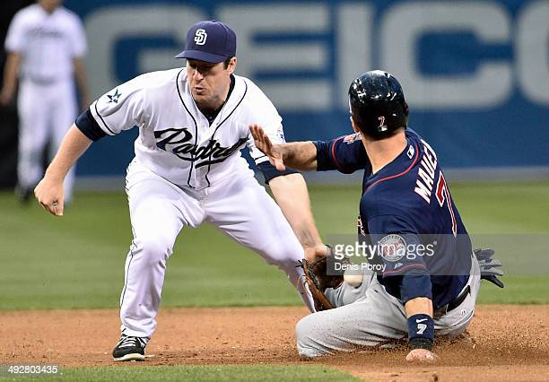 Joe Mauer of the Minnesota Twins steals second base as Jedd Gyorko of the San Diego Padres loses the ball during the sixth inning of a baseball game...