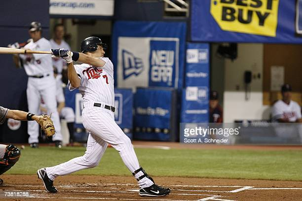 Joe Mauer of the Minnesota Twins swings at a pitch against the Baltimore Orioles during the Opening Day game on April 2 2007 at the Metrodome in...