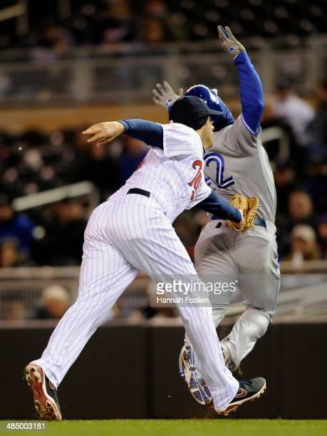 Joe Mauer of the Minnesota Twins tags out Moises Sierra of the Toronto Blue Jays during the sixth inning of the game on April 15 2014 at Target Field...