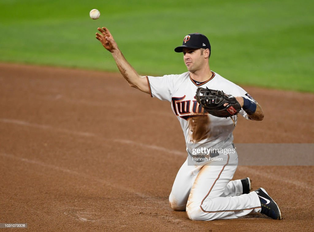 Joe Mauer #7 of the Minnesota Twins throws from his knees to get out Aaron Hicks #31 of the New York Yankees at first base during the fifth inning of the game on September 10, 2018 at Target Field in Minneapolis, Minnesota.