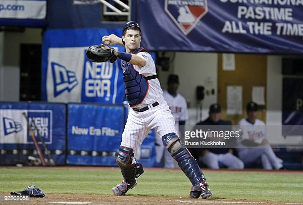 Joe Mauer of the Minnesota Twins throws to first against the New York Yankees on October 11 2009 at the Metrodome in Minneapolis Minnesota The New...